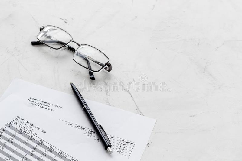 Pay taxes for business on office work desk with glasses and pen white background stock photo