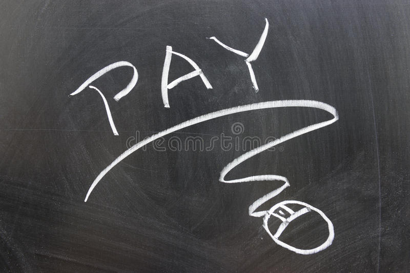 Pay word and mouse sign. Drawn on chalkboard royalty free stock photography