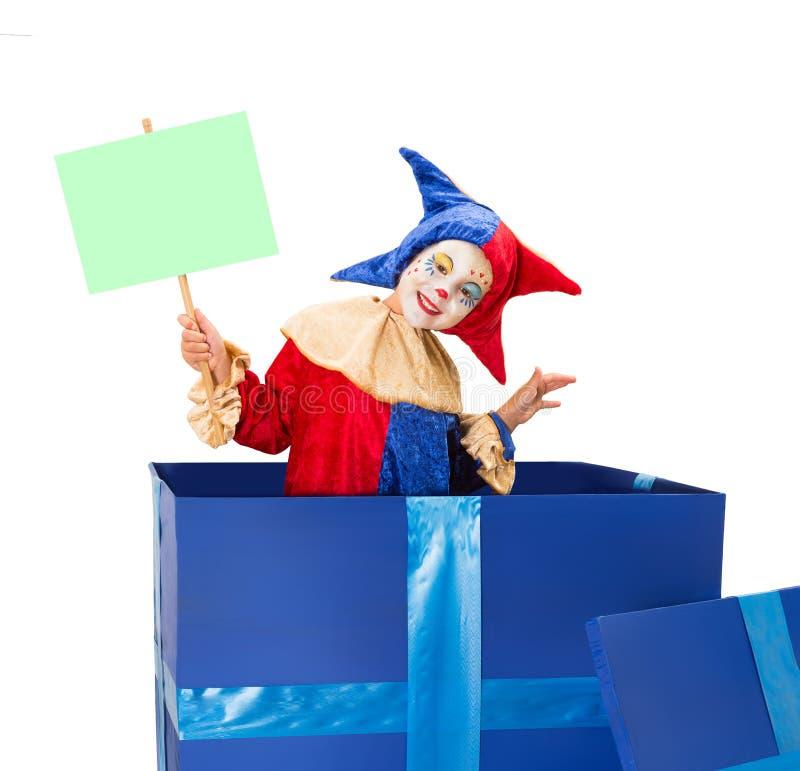 Payaso con la tarjeta en blanco imagen de archivo