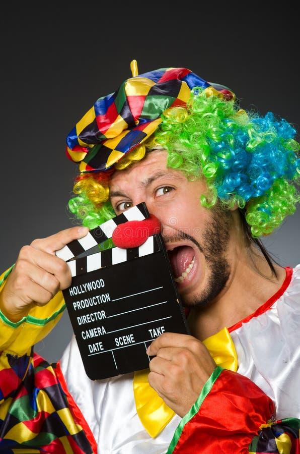 Payaso con película imagen de archivo
