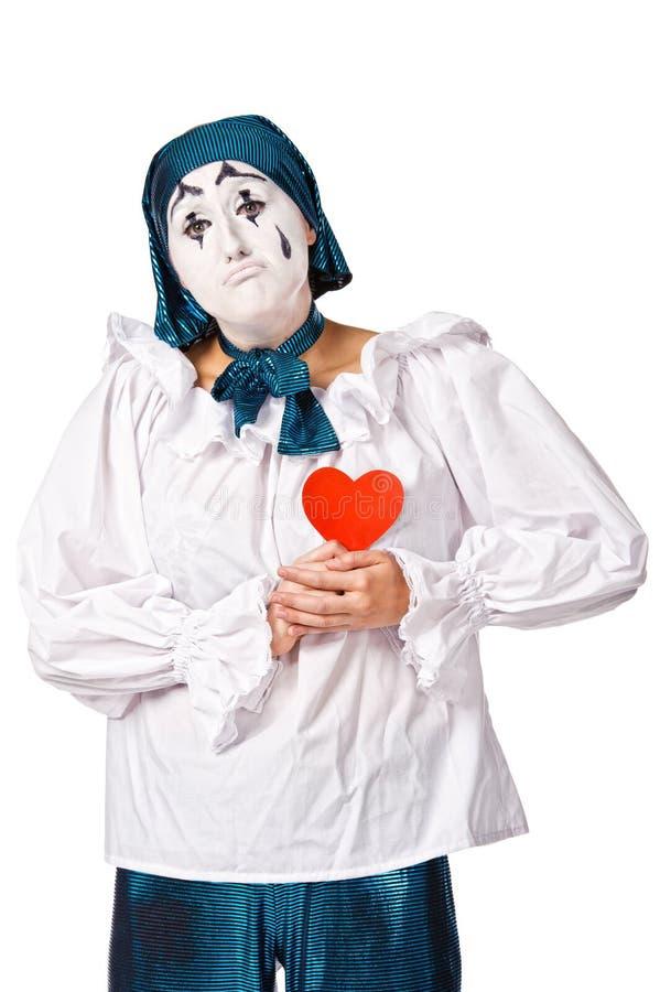 Payaso de sexo femenino triste del mime con un corazón rojo fotos de archivo