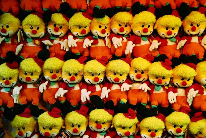 Payasos felices del juguete en una fila fotografía de archivo libre de regalías