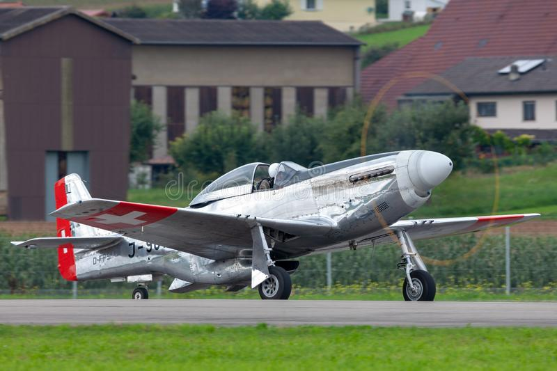 1944 North American P-51D Mustang fighter aircraft Moonbeam McSwine F-AZXS. Payerne, Switzerland - August 29, 2014: 1944 North American P-51D Mustang fighter stock photo