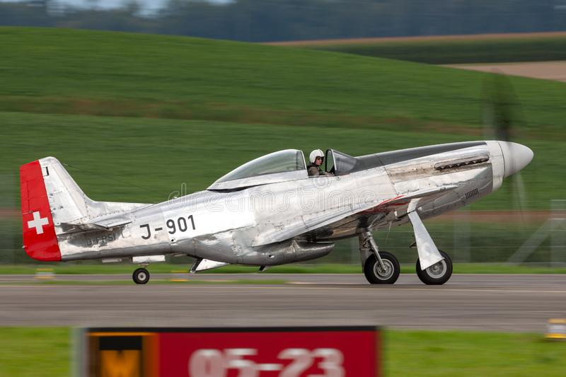 1944 North American P-51D Mustang fighter aircraft Moonbeam McSwine F-AZXS. Payerne, Switzerland - August 29, 2014: 1944 North American P-51D Mustang fighter royalty free stock photography