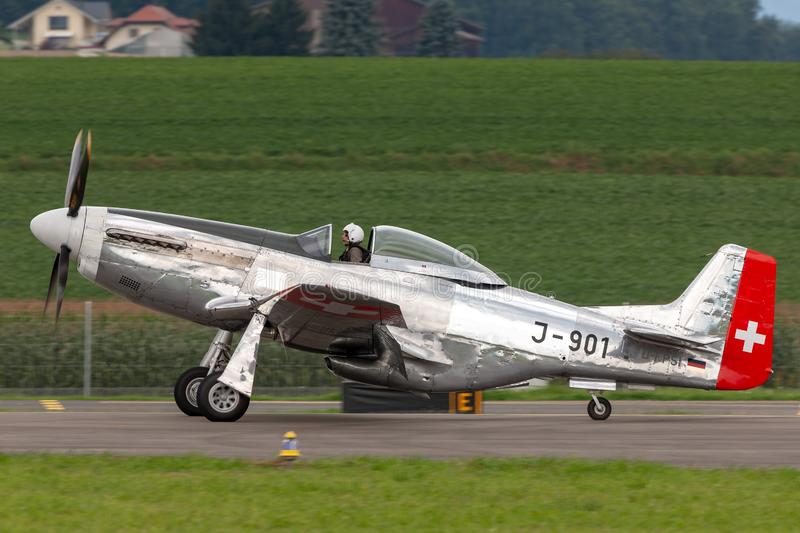 1944 North American P-51D Mustang fighter aircraft Moonbeam McSwine F-AZXS. Payerne, Switzerland - August 29, 2014: 1944 North American P-51D Mustang fighter royalty free stock images