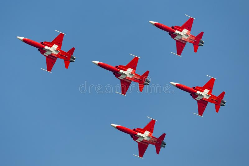 Patrouille Suisse formation display team of the Swiss Air Force flying Northrop F-5E fighter aircraft joined by the Swiss PC-7 tea royalty free stock photos