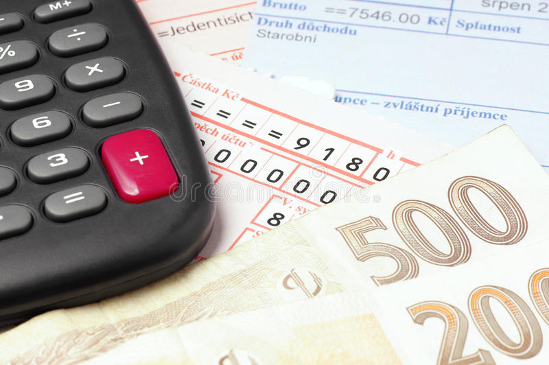 Paying the bills. Counting and paying bills with Czech money royalty free stock photo