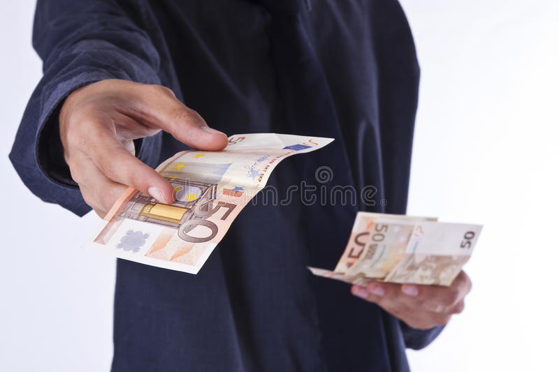Paying bills. Hands in the foreground stock photos