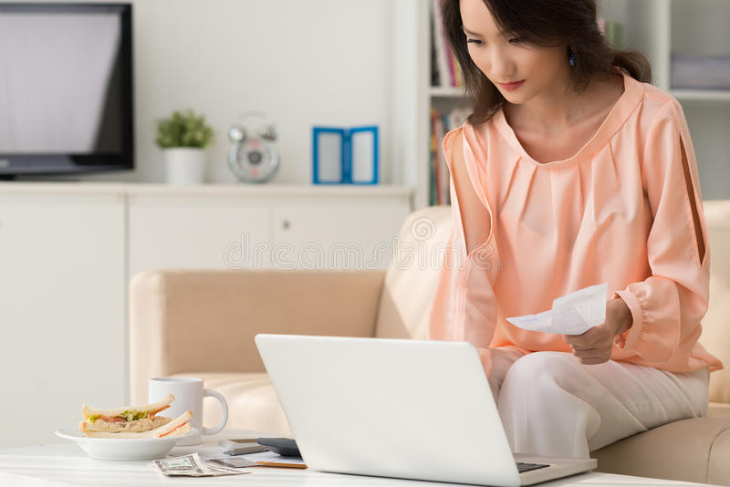 Paying bills online stock photo