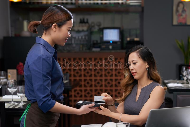 Paying for cafe stock photos