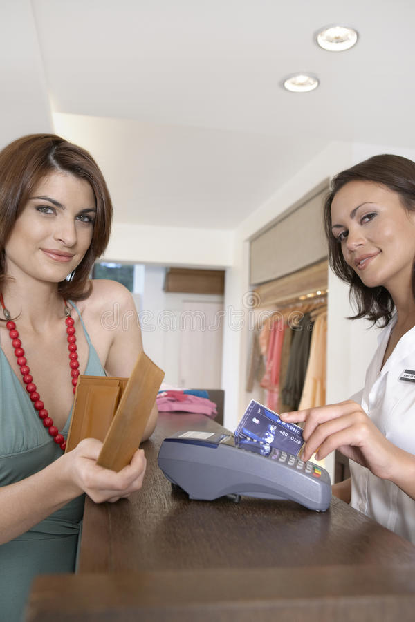 Paying with Card. Client making payment at store's till with credit card stock photography