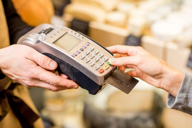 Paying with card in the food store royalty free stock photo