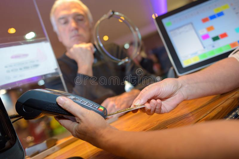 Paying with a card. Pay stock photo