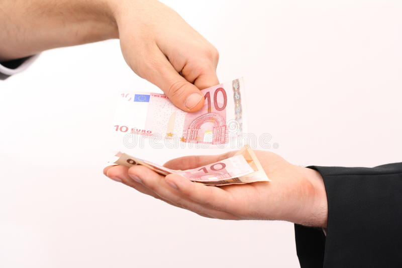 Paying in cash stock photos