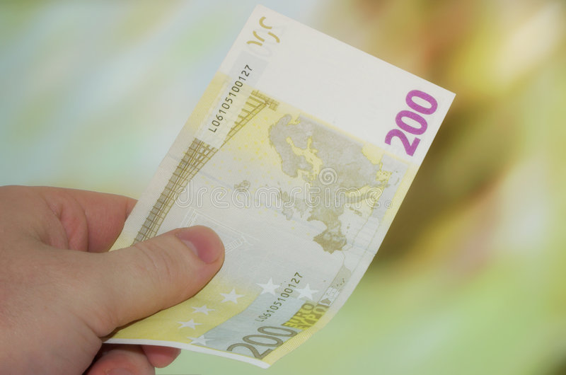 Paying cash. Paying with 200 euro note royalty free stock photography