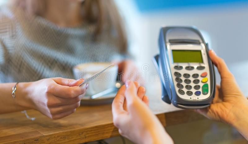 Paying for coffee. Customer Paying Through Credit Card royalty free stock image