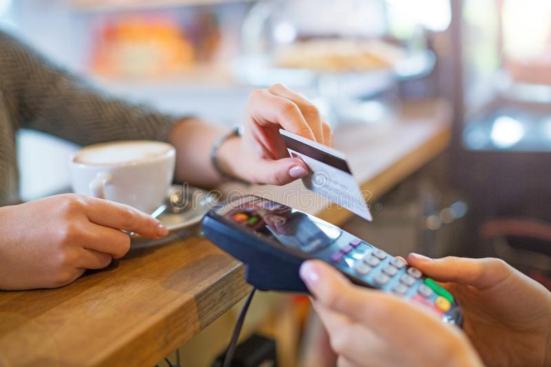 Paying for coffee. Customer Paying Through Credit Card royalty free stock photos
