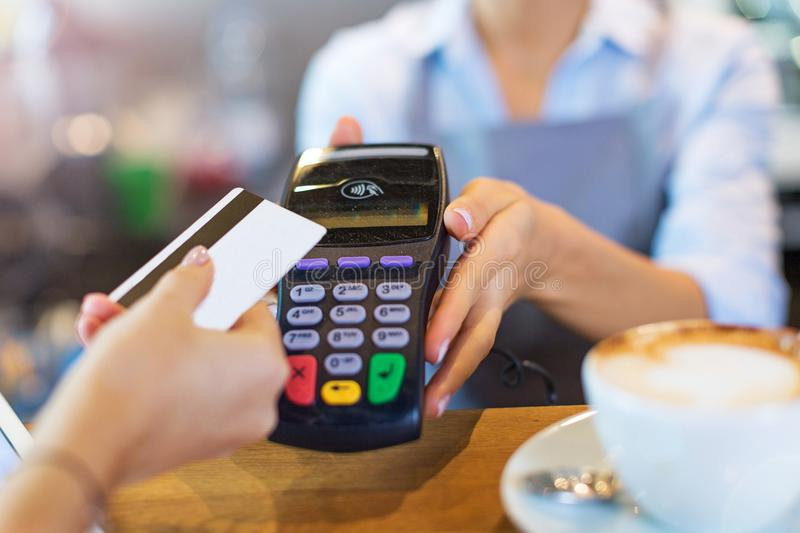 Paying for coffee. Customer Paying Through Credit Card royalty free stock photography