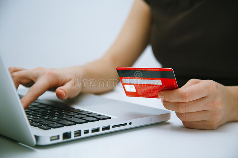 Paying with credit card online. With laptop royalty free stock photo