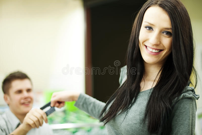 Paying credit card for purchases royalty free stock image