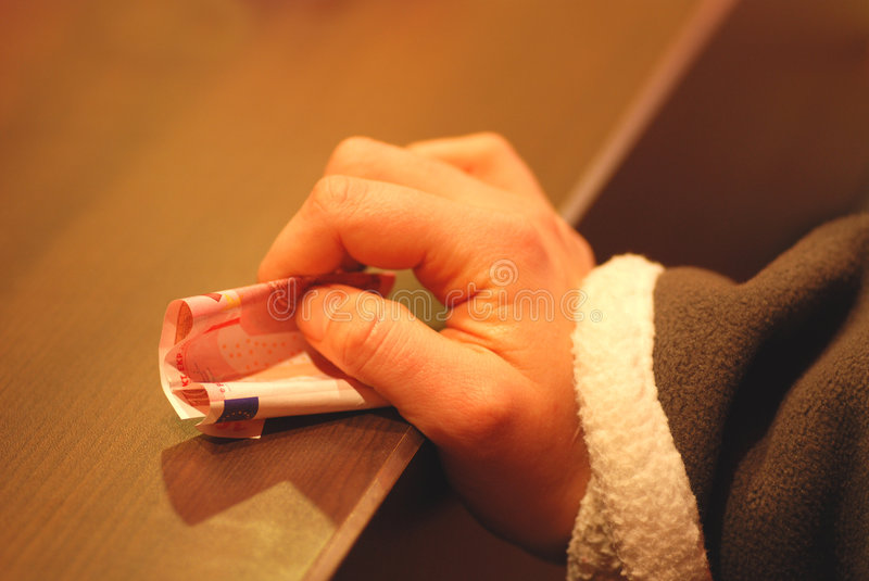 Paying money. Girls hand is paying 10 € for something. At the moment she is waiting stock photography