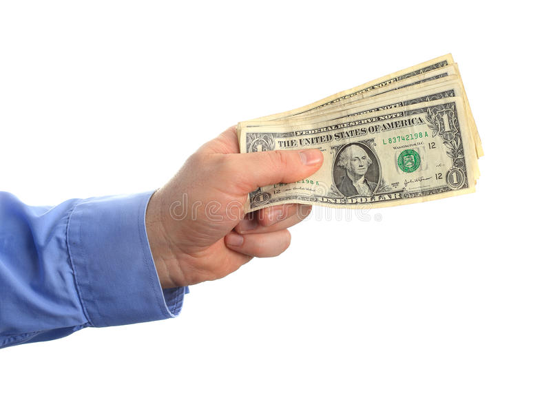 Paying money. Man hand over and paying bunch of money royalty free stock image