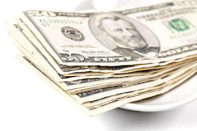 Paying by money on plate. Photo shot of paying by money on plate stock image