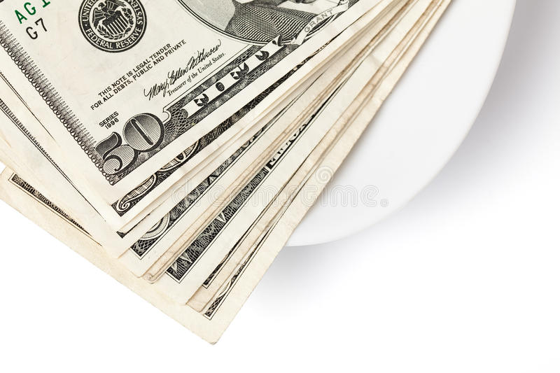 Paying by money on plate. Photo shot of paying by money on plate stock photography