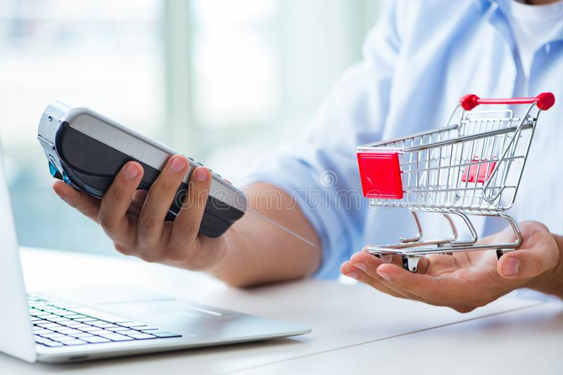 The paying for online purchase with credit at pos. Paying for online purchase with credit at POS royalty free stock photos