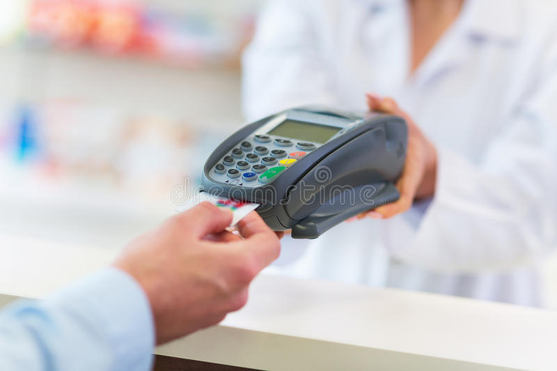 Paying in the Pharmacy stock photos