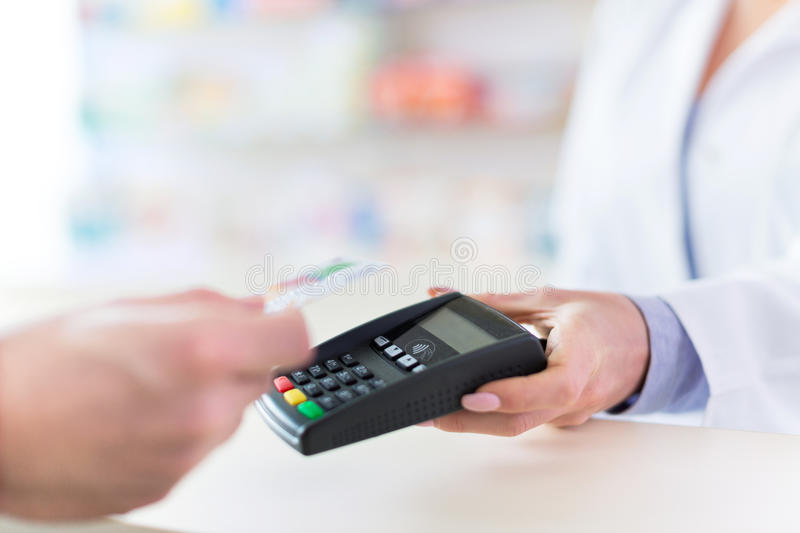 Paying in the Pharmacy stock photography