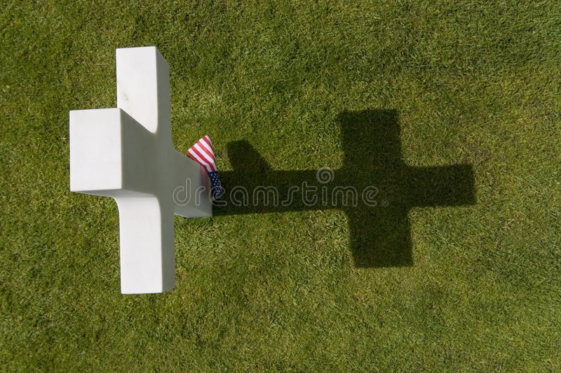 Paying The Price. The grave of a World War 2 US soldier who paid the ultimate price amongst many in the cemetery at Omaha Beach in Normandy Northern France stock image