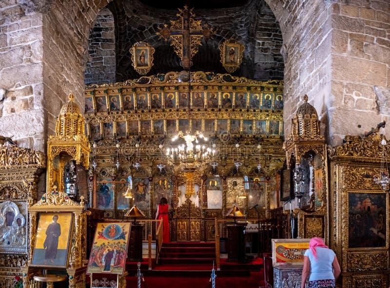 Paying at Saint Lazarus Church. Larnaca, Cyprus - June 11, 2019: Two faithful women pray in the Church of Saint Lazarus stock photography