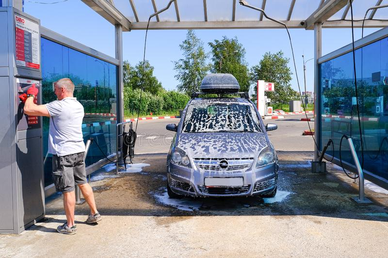 Payment for car wash services through the terminal. Car wash. Self-service washing complex. High pressure car wash. Saint- stock image