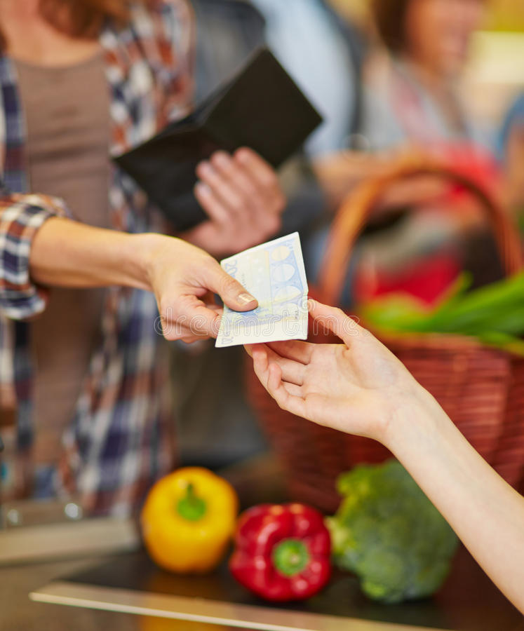 Payment with cash money in supermarket royalty free stock images