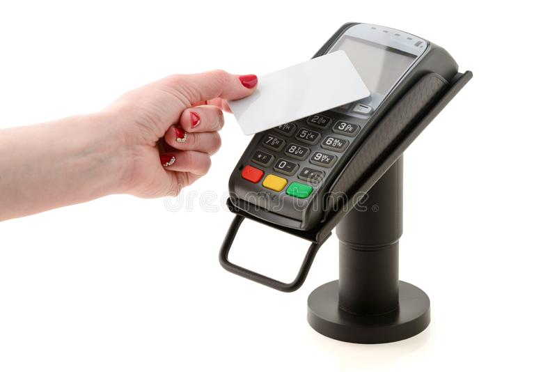 Payment by contactless card through the POS terminal. Isolated on a white stock photos