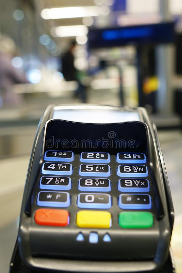 Payment terminal by credit card . Payment in the store stock images