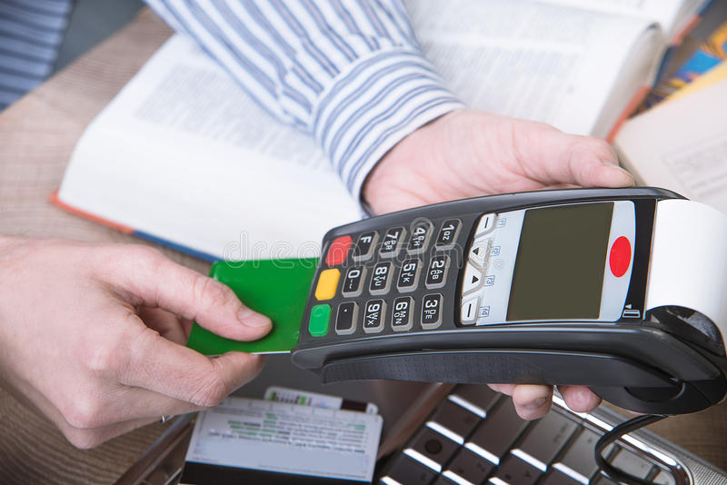 Payment terminal in the office. stock photos