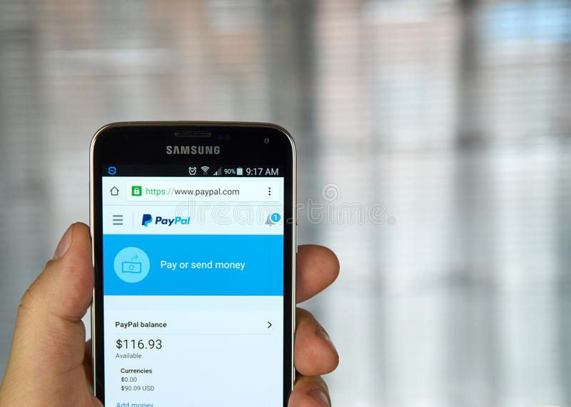 PayPal on a cell phone. MONTREAL, CANADA - MARCH 8, 2016 - PayPal mobile application on screen of Samsung S5 in hand stock photography