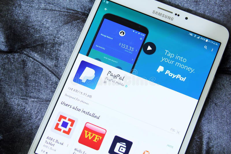 Paypal. Downloading paypal from google play store on samsung tab s2 stock images