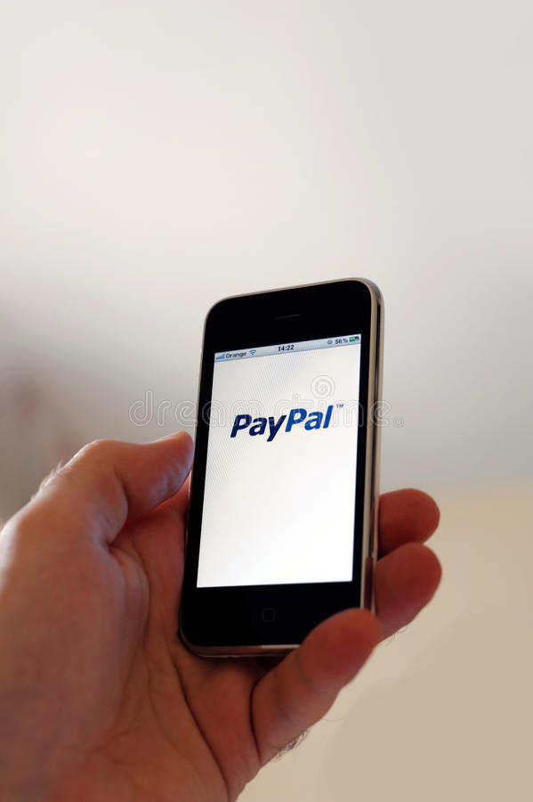 PayPal Mobile payments. Smartphone screen of the online payment site PayPal on a mobile phone terminal (iPhone stock photography