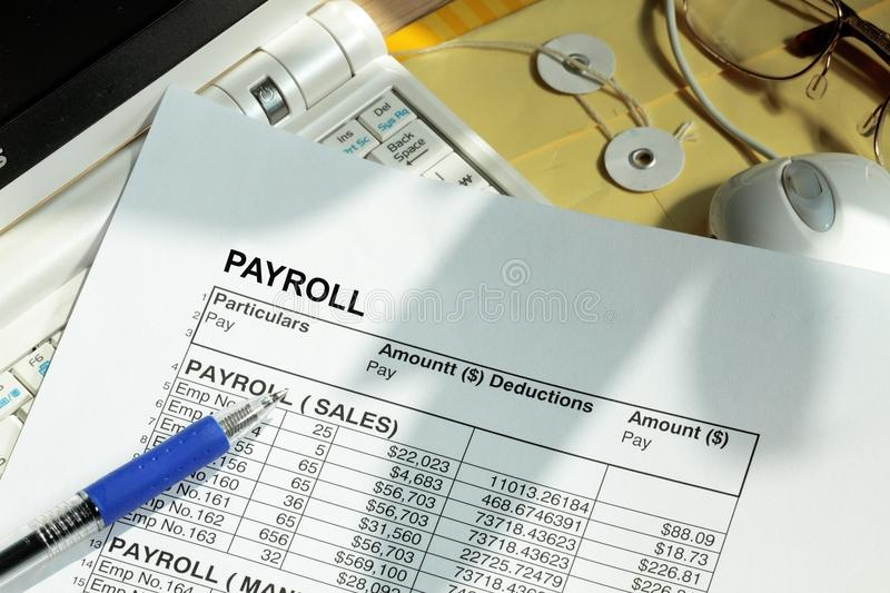 Payroll spreadsheet. With computer monitor and mouse stock photos