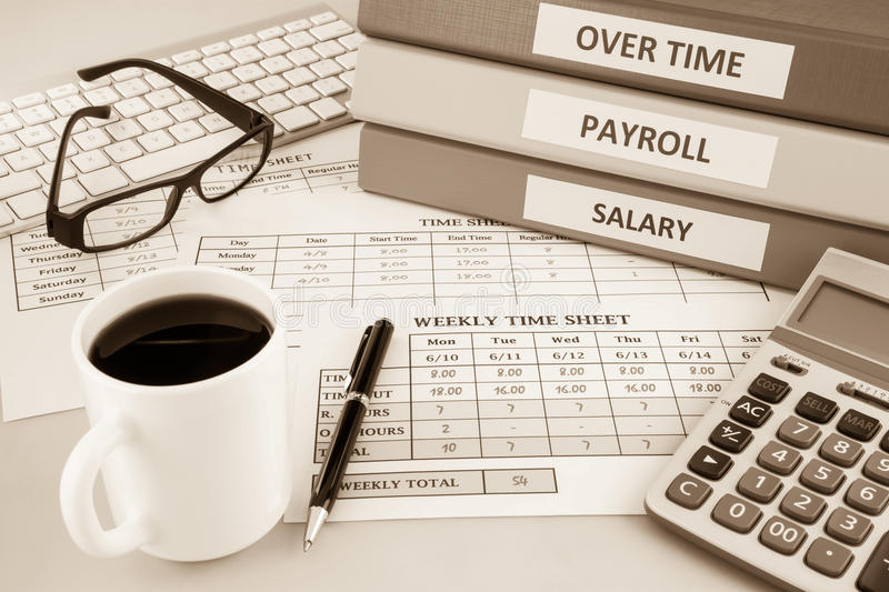 Payroll time sheet for human resources, sepia tone royalty free stock image
