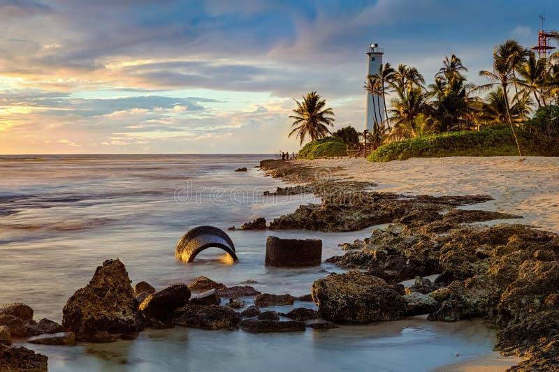 Paysage marin de coucher du soleil de phare de point de coiffeurs image stock