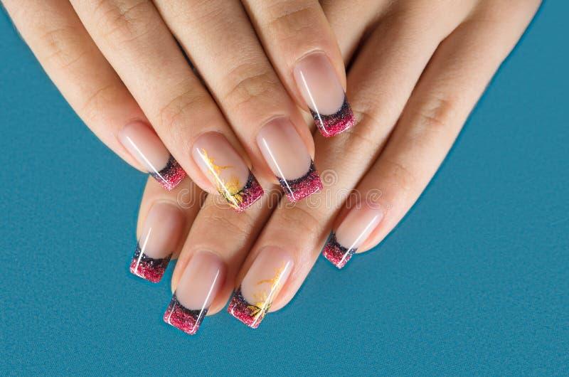 Paznokcie z czerwonym manicure'em obrazy stock