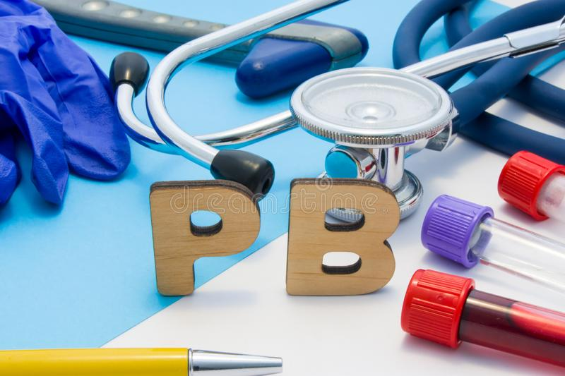 PB Medical lab acronym, meaning lead or plumbum in human body. Letters that make word of PB, located near test tubes with blood, s stock image