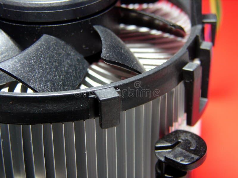 PC cooling fan. Close up macro on red background symbolizing heat stock image