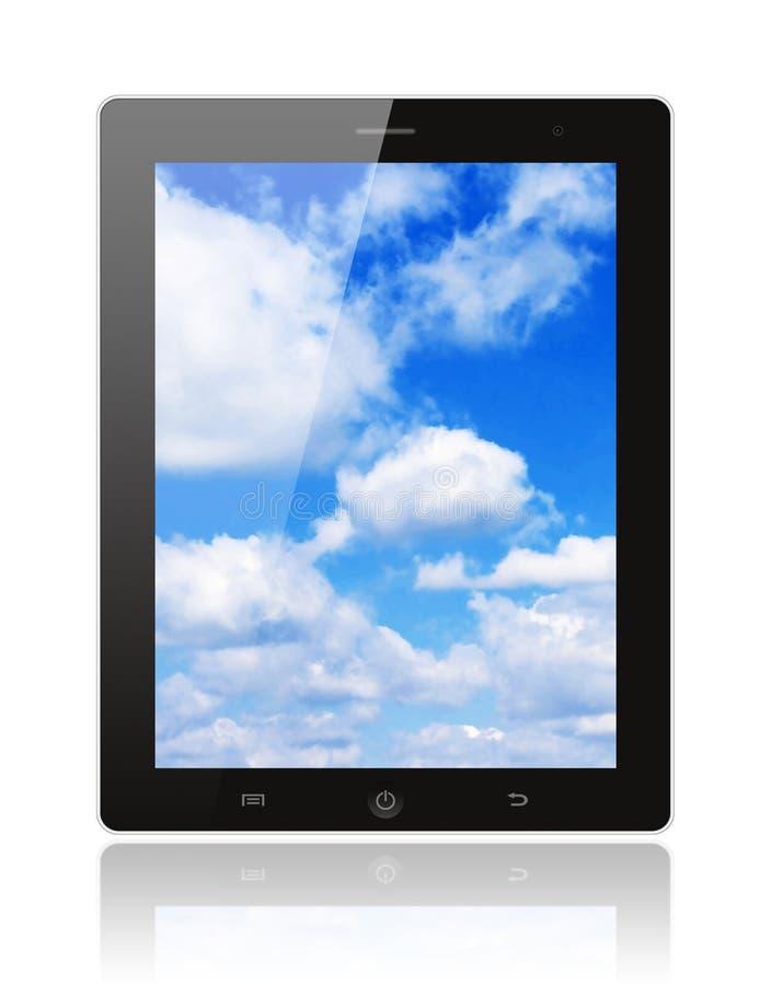 PC de la tableta con el cielo azul fotos de archivo libres de regalías