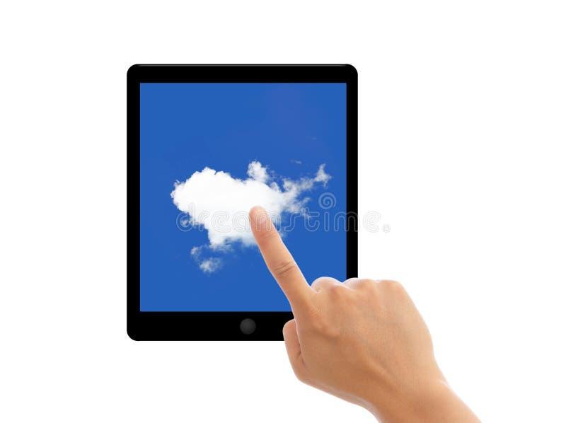 PC de la tablilla de la punta del dedo con las nubes en la pantalla imagen de archivo libre de regalías