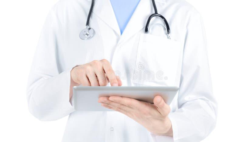 PC del doctor Working With Digital Tablet foto de archivo